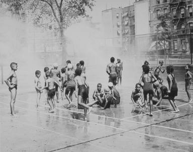 Group of children in park sprinkler