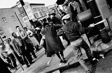 Man swinging club at Black woman on Montgomery, Alabama street