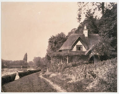 River scene with cottage