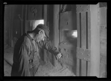 Worker looking in Machine