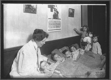 Woman with Group of Children resting Health Center