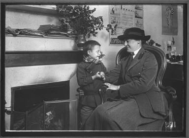 Woman Officer and Small Boy