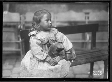 Portrait of a Child with Pet