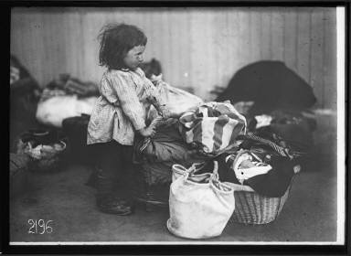 Child with Baskets of Clothing