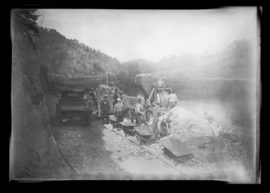 Workers Moving Earth with Heavy Equipment