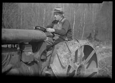 Portrait of a Man on a Tractor