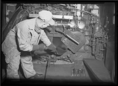 RR Worker Shoveling Coal