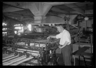 Man Inspecting Press