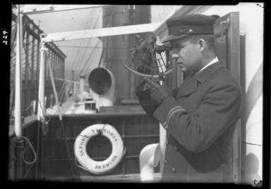 Ship Captain Holding Sextant