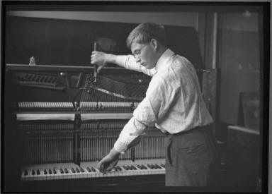 Boy Tuning Piano