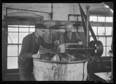 Two Men Testing Vat Temperature
