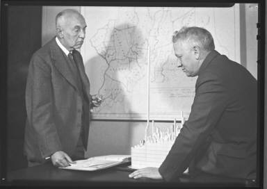 Two Men With Maps