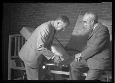 Two Men Upholstering