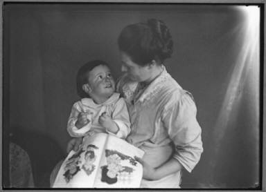 Woman with Laughing Baby