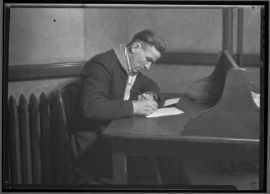 Man Writing Letter at Desk