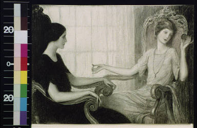 Two women seated facing each other