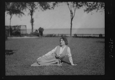 Savagoy, Henriette, seated on a lawn