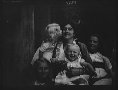 Unidentified woman with four children, portrait photograph