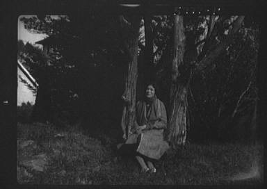 Bigelow, Dorothy, Miss, seated outdoors