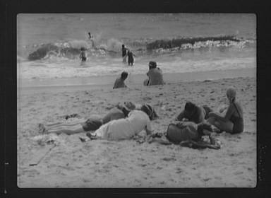 Unidentified group of people, possibly members of the Jewett family, at the beach