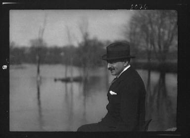 Unidentified man, seated outdoors