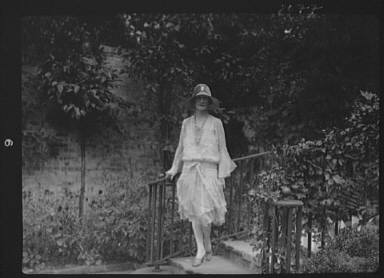 Unidentified woman, standing outdoors