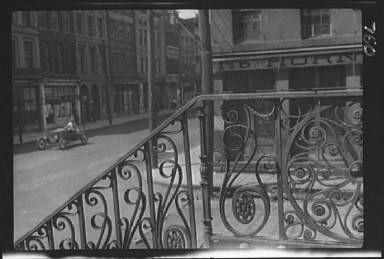 Street seen from behind the wrought iron railing of the Market Hall, Charleston, South Carolina