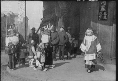 Women and children walking down a street, Chinatown, San Francisco