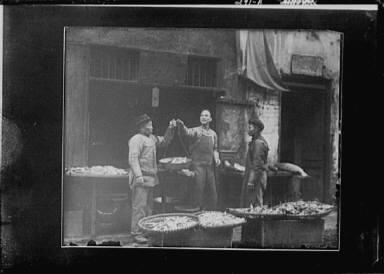Weighing fish, Chinatown, San Francisco