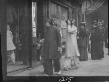 Chinese and American women walking down a street, Chinatown, San Francisco