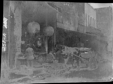 Vendors and a horse and cart on a street, Chinatown, San Francisco