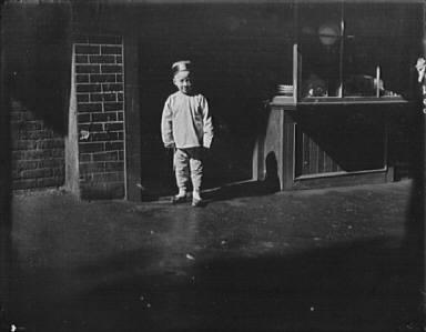 Boy in doorway of lamp store, Chinatown, San Francisco