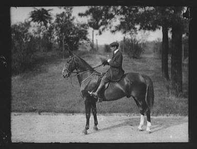 Unidentified man riding Chesty