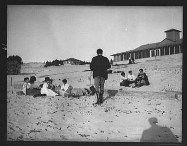 Arnold Genthe photographing George Sterling, Mary Austin, Jack London and Jimmie Hooper on the beach at Carmel, California
