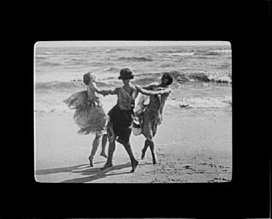 Three dancers on the beach