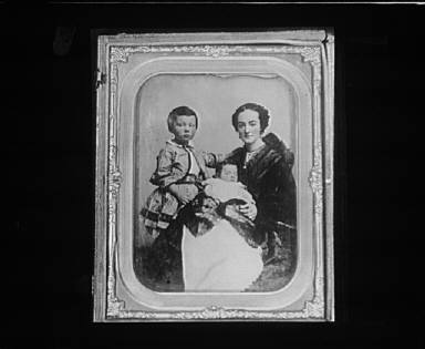 Portrait photograph of a mother and her children