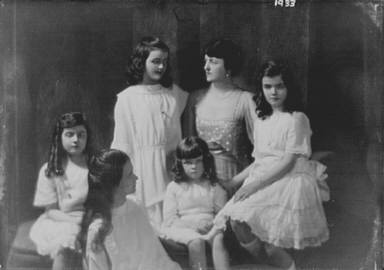 Kelly, C.F., Mrs., and daughters, portrait photograph