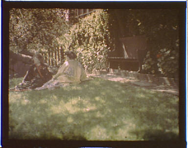 Two women wearing kimonos in the garden of Genthe's studio in San Francisco