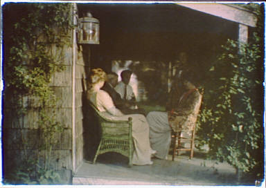 People seated on a porch