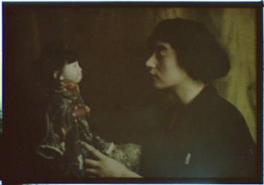 May Kushland holding a doll