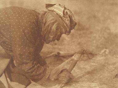 Fleshing a Hide-Blackfoot