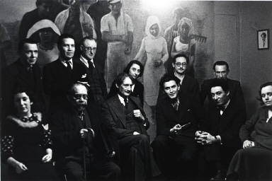 Henri Barbusse (center) surrounded by leading left-wing intellecutals in his office of the literary journal 'Monde', Paris