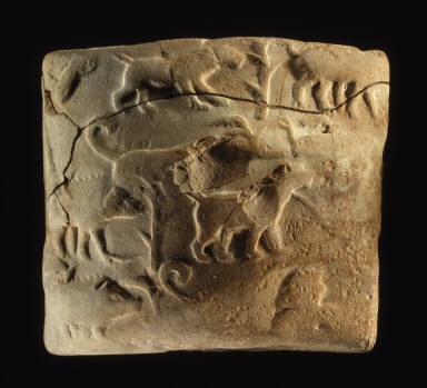 Administrative tablet with cylinder seal impression of a male figure, hunting dogs, and boars