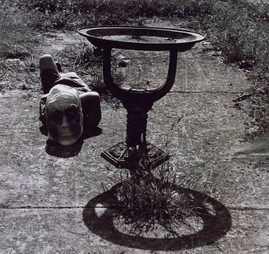 Untitled (Child Lying on Ground with Mask)