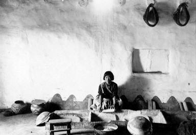 Hopi Woman Grinding Corn