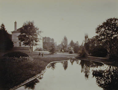 View over the Pond [children playing croquet, man mowing lawn]