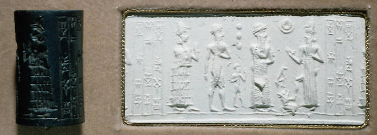 Cylinder seal: Presentation scene. King between goddess and priest stand