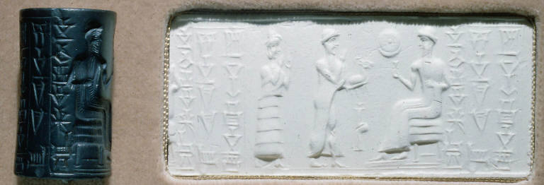 Cylinder seal: Enthroned bearded divinity holding a flower, approached by two worshippers