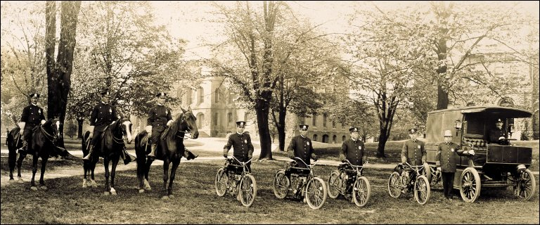 Police officers with horses, motorcycles and police van