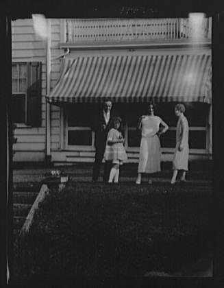 Dunning family, standing outside house